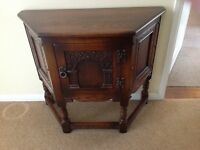 A lovely hand carved oak Telephone Table/Canted Hall Cabinet by Old Charm, Wood Bros.