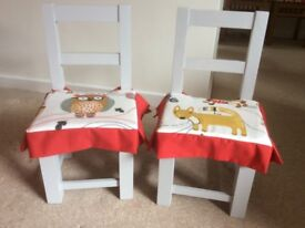 Pair of painted children's chairs with detachable cushions
