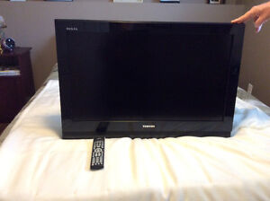 """Toshiba 31"""" flat screen tv with wall mount"""