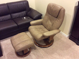 Reclining leather chair with an ottoman