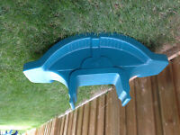 Outside toddler toys: teeter totter and airplane