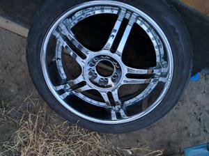 "Brand ne Nitto tires on chrome 24"" Divinci rims"