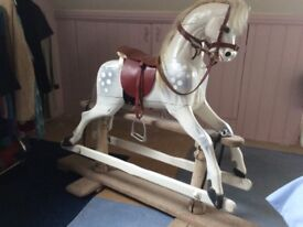 Rocking horse, with red leather tack