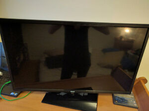 "RCA 32"" LED flat screen TV with DVD player built in"