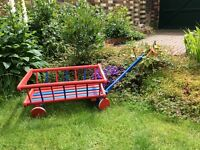 Wooden garden trolley on wheels
