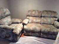 Two la-z-boy reclining love seats and reclining chair