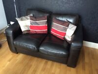 Stylish leather sofa looking for a new home-bargain at only £65