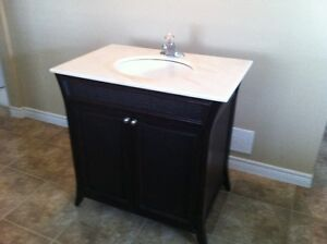Vanity with marble top sink and taps