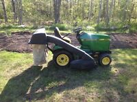 John Deere 265 with attachments