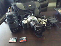 Canon 400D camera and lenses ( 18-55mm& 75-300mm) cables, bag