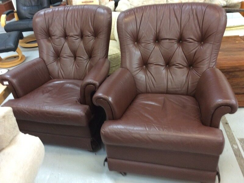 Two button-back leather chairs