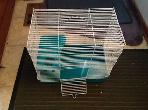 Nice pet cage ,has shelf , only 15 dollars