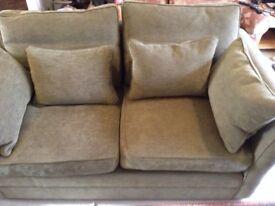 Green large sofa. (Fire regs)