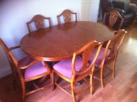 Oval shape yew table with 6 chairs