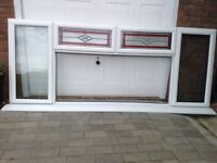 Large white used pvc window with top stained glass
