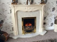 Real marble fire place with electric fire