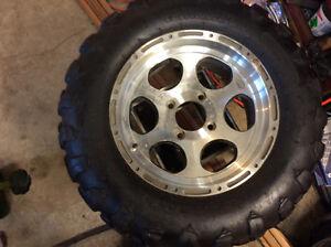 4 Arctic Cat tires,14in. 2 on rims
