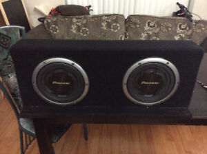 2 car amplifiers attached on a slim subwoofer box of 10' subs