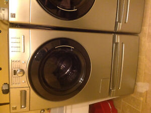 Kenmore front loading washer and dryer with pedestals