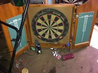 Dart board with cabinets and darts