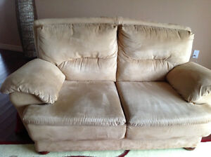 Beautiful sofa with matching chair for sale. Beige colour.