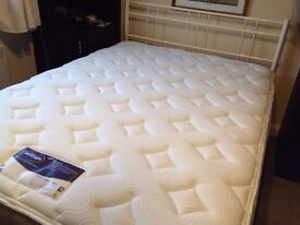 """Brand new metal frame 4' 6"""" bed base and brand new Silent night Pocket Memory 2800 mattress."""