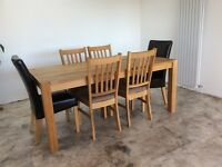 Oak dining table and six chairs, matching coffee table and side table.