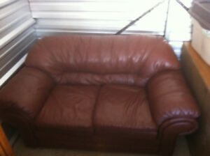 2 brown leather love seats