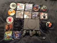 PS1 with 2 pads and 14 games. Bundle, all tested and working.