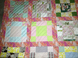 hand made and quilted twin size quilt for sale