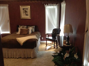 Large suite 5 min to OK College $950.00