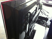 """samsung 46"""" LCD TV with silver wood and glass stand"""