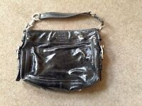 Genuine Coach handbag. Black patent. Used one.