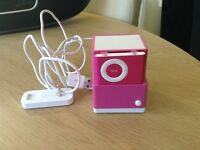 Pink mini iPod with speaker and charger