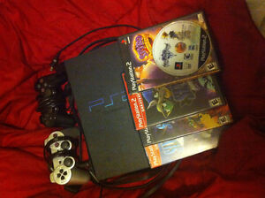 URGENT! PS2 for sale! 2 Controllers, 5 games and memory card!