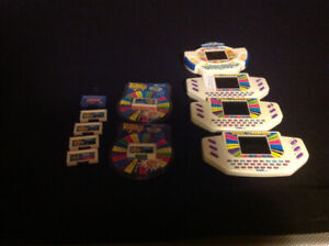 For sale, several wheel of fortune hand held games and remotes