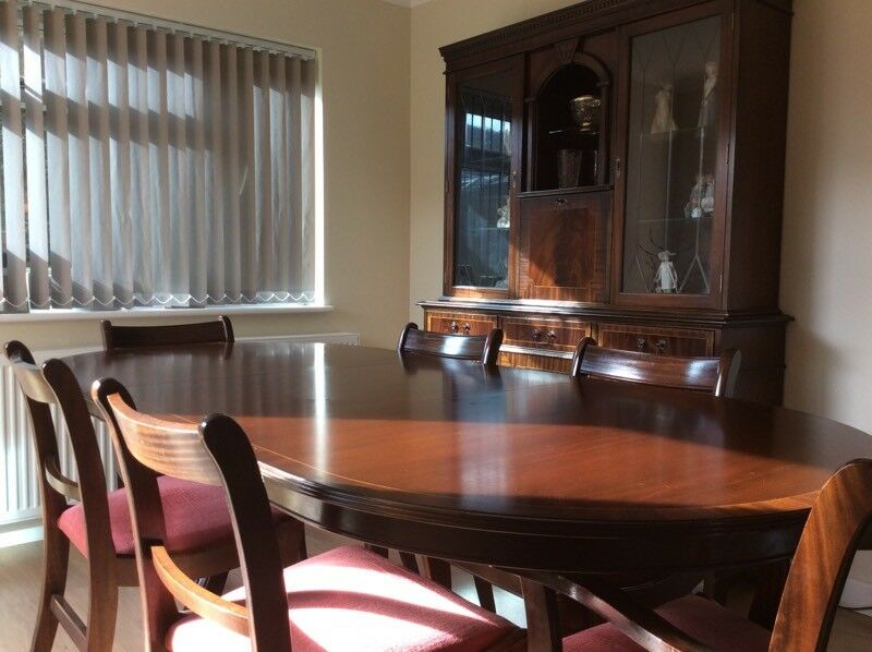 Mahogany reproduction dining suite including table 6 chairs and 2 piece dresser