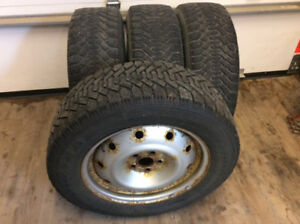 Snow tires on 5 hole rims ( off a Subaru Forester)