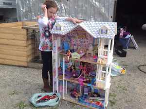4 foot Barbie house with furniture, Barbies, Bratts and more.