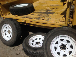 4 trailer tires mounted on 6 bolt rims 225 x 75 x 16
