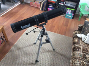 Bushnell Telescope with weighted tripod.