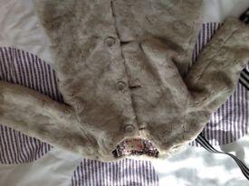 Girl's fur coat age 4-5.