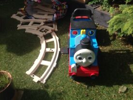 Thomas tank engine ride on train with track.