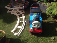 Thomas tank engine ride on train with track.