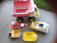 2 dump trucks, grader, 3 boats. $10.00