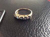 9 ct gold ring set with 5 blue stones