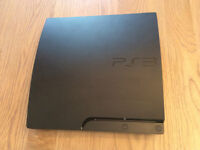 Black Slim ps3 in good condition with 2 controllers and 14 games