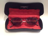 Ladies Chanel sunglasses. Brown frameless lens and arms. Original case and cloth