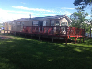 FINANCING AVAILABLE WATERFRONT 3 SEASON COTTAGE LIKE RV
