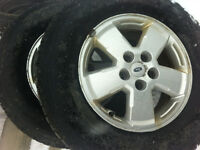 Ford escape wheels and tires 235/70-16 Firestone winterforce